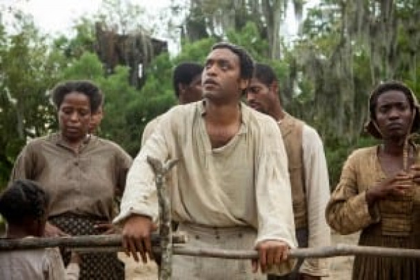 "Chiwetel Ejiofor, center, stars in a scene from the movie ""12 Years a Slave."" The Catholic News Service classification is L -- limited adult audience, films whose problematic content many adults would find troubling. The Motion Picture Association of America rating is R -- restricted. Under 17 requires accompanying parent or adult guardian. (CNS photo/Fox Searchlight) (Nov. 20, 2013) See MOVIE REVIEW Nov. 20, 2013."